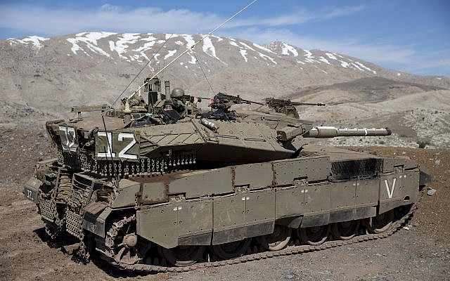 Israeli soldiers peer into Syria from their tank in the Golan Heights on February 18, 2016. (Ariel Schalit/AP Photo)