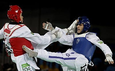 Illustrative: Ron Atias of Israel, and Venilton Teixeira of Brazil compete in the men's Taekwondo event at the 2016 Summer Olympics in Rio de Janeiro, Brazil, Wednesday, Aug. 17, 2016. (AP Photo/Andrew Medichini)