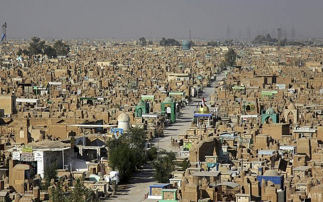 """The Wadi al-Salam, or """"Valley of Peace"""" cemetery which contains the graves of victims of violence of Iraq's contemporary history, from the ruinous 1980-88 war with Iran to the costly 1990-91 conflict over Kuwait and 13 years of uninterrupted bloodshed starting with the U.S. led invasion in 2003. (AP Photo)"""