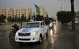Members of of Hamas's armed wing ride vehicles on the streets of Beit Lahiya, Gaza Strip, Thursday, Dec. 8, 2016. (AP Photo/Adel Hana)