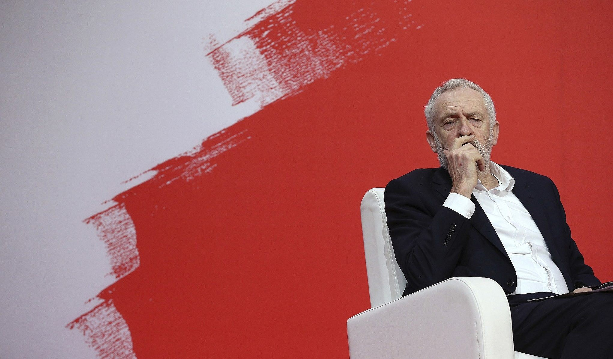 Jeremy Corbyn, leader of Britain's Labour Party, listens to speakers during the Party of European Socialists Council in Lisbon, December 2 2017. (AP Photo/Armando Franca)
