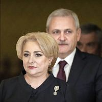 Romanian Prime Minister Viorica Dancila, left, arrives, followed by the leader of the ruling Social Democratic party Liviu Dragnea for the swearing in ceremony of her cabinet, in Bucharest, Romania, Monday, January 29, 2018. (AP Photo/Vadim Ghirda)