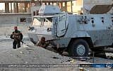 "Illustrative: This photo posted on a file sharing website Wednesday, Jan. 11, 2017, by the Islamic State Group in Sinai, shows a deadly attack by militants on an Egyptian police checkpoint, Monday, Jan. 9, 2017, in el-Arish, north Sinai, Egypt. Arabic reads, ""Clash with light arms with the remaining apostates left alive at the fire station checkpoint."" Egypt's military says it has begun a major security operation in areas including the restive northern Sinai Peninsula, where Islamic militants are most active. (Islamic State Group in Sinai, via AP, File)"