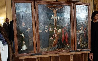 Illustrative: Oil work entitled 'Triptych of the Crucifixion' attributed to Flemish painter Joachim Patinir during a ceremony of restitution at Culture ministry in Paris, Monday, Feb. 12, 2018. (AP Photo/Francois Mori)