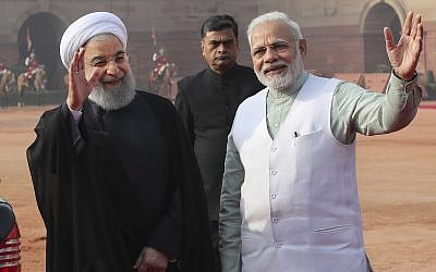 Indian Prime Minister Narendra Modi, right, and Iranian President Hassan Rouhani, left, wave after a ceremonial reception at the Indian presidential palace, in New Delhi, India, February 17, 2018. (AP Photo/Manish Swarup)