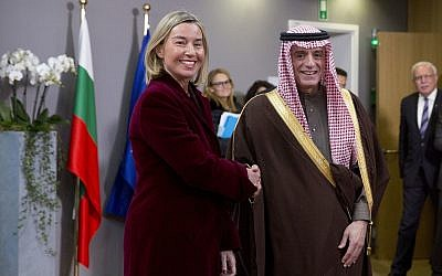 European Union foreign policy chief Federica Mogherini, left, greets Saudi Arabia's Foreign Minister Adel al-Jubeir after a meeting of EU foreign ministers at the Europa building in Brussels on Monday, Feb. 26, 2018. European Union foreign ministers met in Brussels on Monday to debate ways to revive Middle East peace efforts and discuss the crisis in Venezuela. (AP Photo/Virginia Mayo)