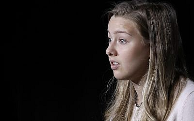 Chessy Prout, the author of 'I Have the Right To: A High School Survivor's Story of Sexual Assault, Justice and Hope,' talks during an interview, March 6, 2018, in New York. (AP Photo/Mark Lennihan)