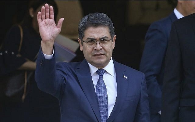 President of Honduras Juan Orlando Hernandez waves during a visit to Santiago, Chile, March 10, 2018. (Esteban Felix/AP)