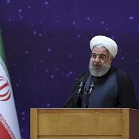 "Iranian President Hassan Rouhani speaks in a ceremony to mark ""National Nuclear Day,"" dedicated to the country's achievements in nuclear technology, in Tehran, Iran, April 9, 2018. (Iranian Presidency Office via AP)"