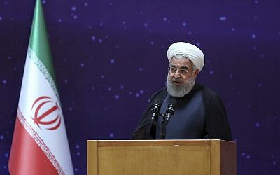"""Iranian President Hassan Rouhani speaks in a ceremony to mark """"National Nuclear Day,"""" dedicated to the country's achievements in nuclear technology, in Tehran, Iran, April 9, 2018. (Iranian Presidency Office via AP)"""