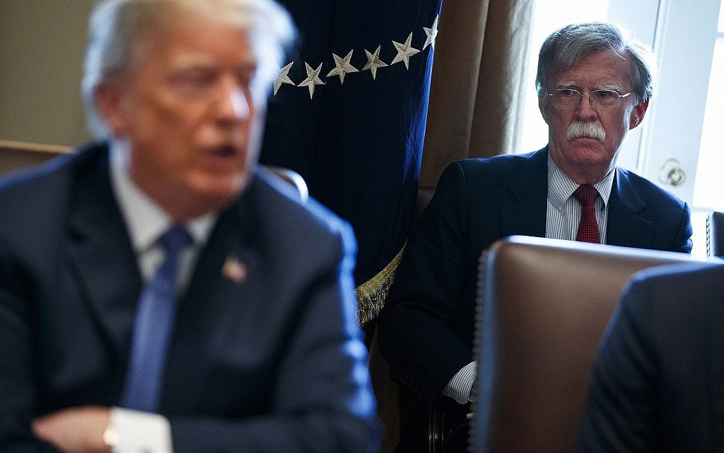 US National Security Adviser John Bolton listens as US President Donald Trump speaks during a cabinet meeting at the White House on April 9, 2018. (AP Photo/Evan Vucci)
