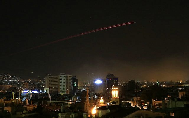 Damascus skies erupt with anti-aircraft fire as the US launches an attack on Syria targeting different parts of the Syrian capital Damascus, Syria, early Saturday, April 14, 2018. (AP Photo/Hassan Ammar)