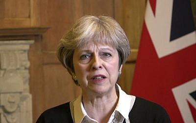In this image made from video provided by UK Government via AP Video,  British Prime Minister Theresa May speaks in London,  Saturday, April 14, 2018. (UK Government via AP Video)
