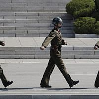 In this Wednesday, April 18, 2018 photo, North Korean soldiers march at the border village of Panmunjom in the Demilitarized Zone with South Korea. (AP Photo/Lee Jin-man)