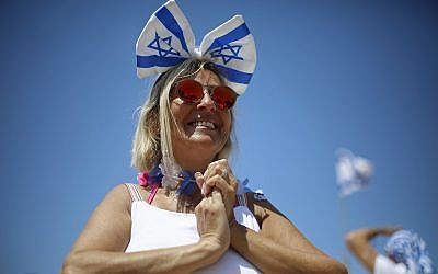 A woman smiles during Independence Day celebrations marking 70 years since the founding of the state in 1948, in Tel Aviv, Israel, Thursday, April 19, 2018. (AP Photo/Ariel Schalit)