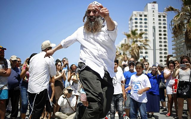 People dance during Independence Day celebrations marking 70 years since the founding of the state in 1948, in Tel Aviv, Israel, Thursday, April 19, 2018. (AP Photo/Ariel Schalit)