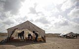Palestinian protesters set up tents at the Gaza Strip's border with Israel, Thursday, April 19, 2018 (AP Photo/ Khalil Hamra)
