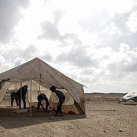 Palestinian protesters set up tents at the Gaza Strip's border with Israel, Thursday, April 19, 2018 (AP Photo/ Khalil Hamra)