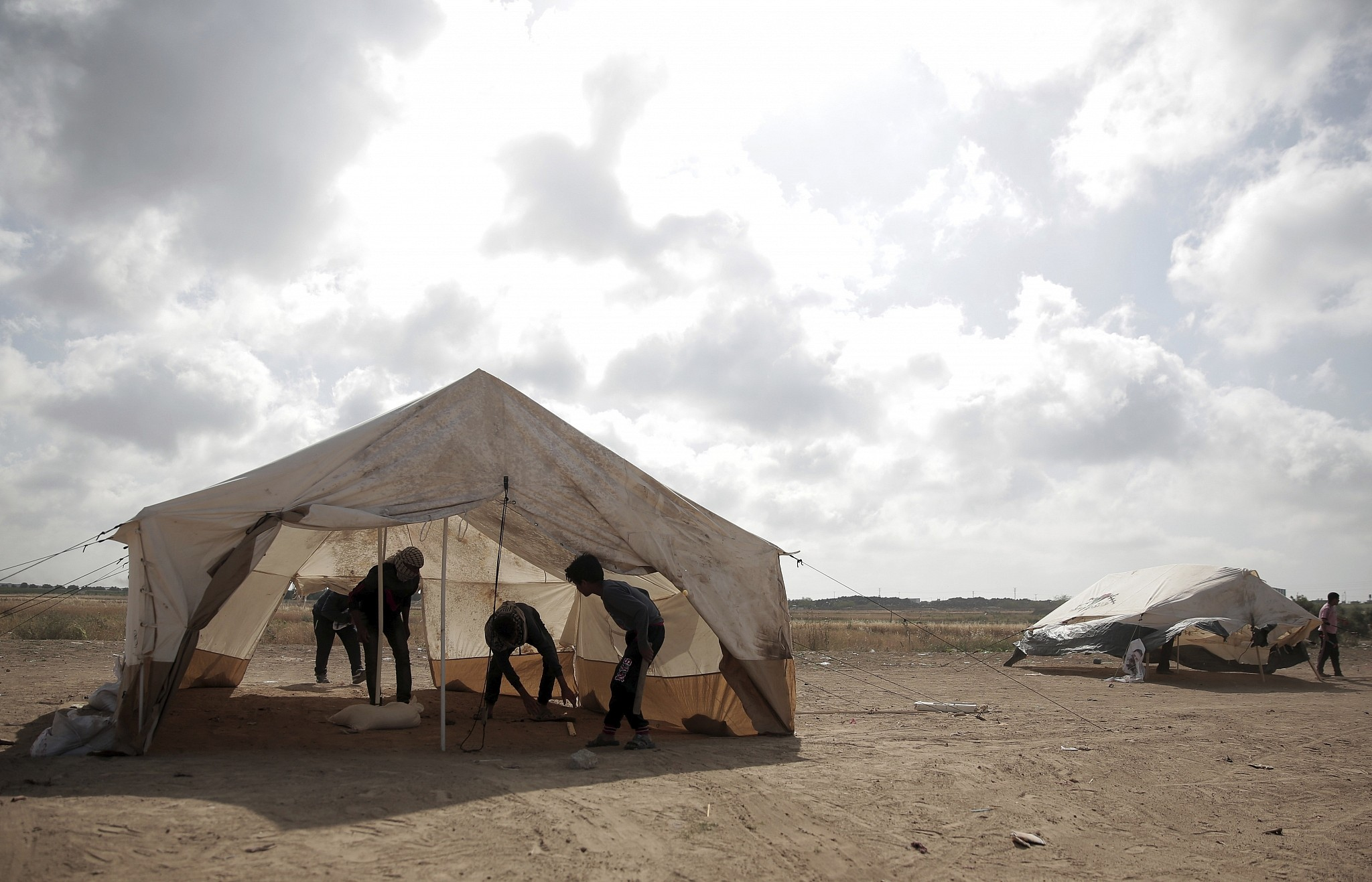 Palestinian protesters set up tents at the Gaza Strip's border with Israel Thursday