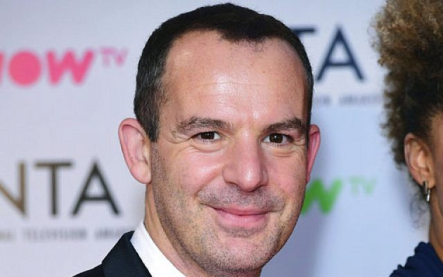 In this Jan. 23 2018 file photo, MoneySavingExpert founder Martin Lewis  poses for a photo at the NTA show,. (Ian West/ PA via AP)