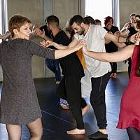 In this April 15, 2018 photo a group of people take part in a workshop, led by Syrian migrants, to learn the traditional Arabic dance Dabke in Berlin, Germany. (AP Photo/Jona Kallgren)