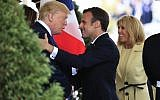 US President Donald Trump with first lady Melania Trump greet visiting French President Emmanuel Macron and his wife Brigitte Macron upon arrival at the White House in Washington, April 23, 2018. (AP Photo/Manuel Balce Ceneta)