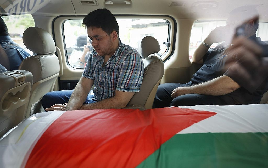 The coffin of Palestinian Fadi al-Batsh is seen in a hearse out of a hospital's morgue in Selayang, on the outskirt of Kuala Lumpur, Malaysia, Wednesday, April 25, 2018 (AP Photo/Vincent Thian)