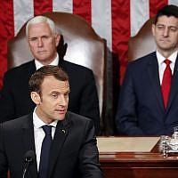 French President Emmanuel Macron speaks to a joint meeting of Congress on Capitol Hill in Washington, Wednesday, April 25, 2018. Standing behind him are Vice President Mike Pence and House Speaker Paul Ryan of Wisconsin, (AP Photo/Pablo Martinez Monsivais)