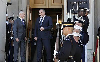 US Defense Secretary Jim Mattis, left, and Israeli Minister of Defense Avigdor Liberman enter the Pentagon for their meeting, Thursday April 26, 2018, at the Pentagon. (AP Photo/Jacquelyn Martin)