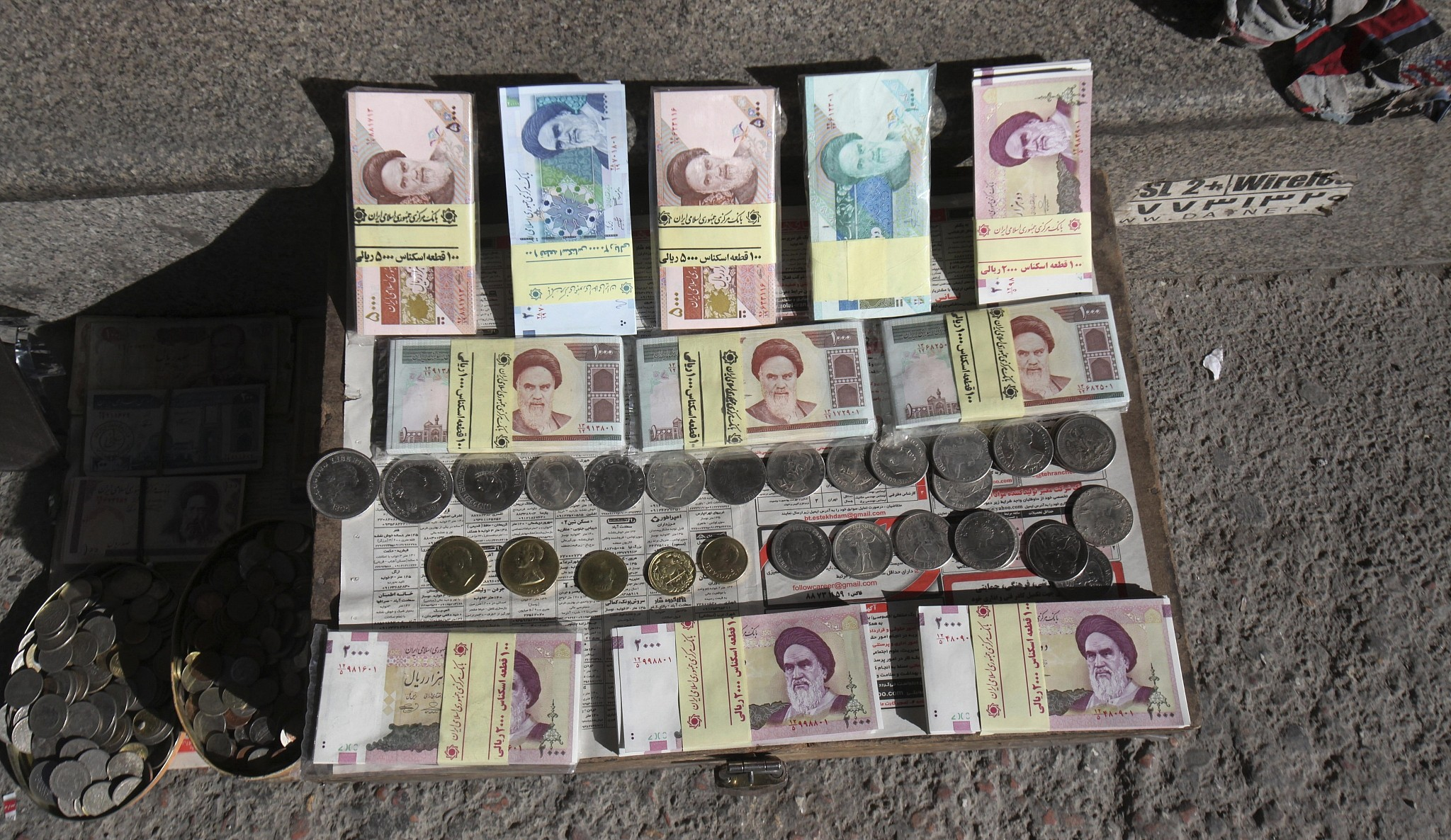 Ilrative Photo Of Iranian Banknotes And Foreign Coins Displayed By A Vendor On Side Walk