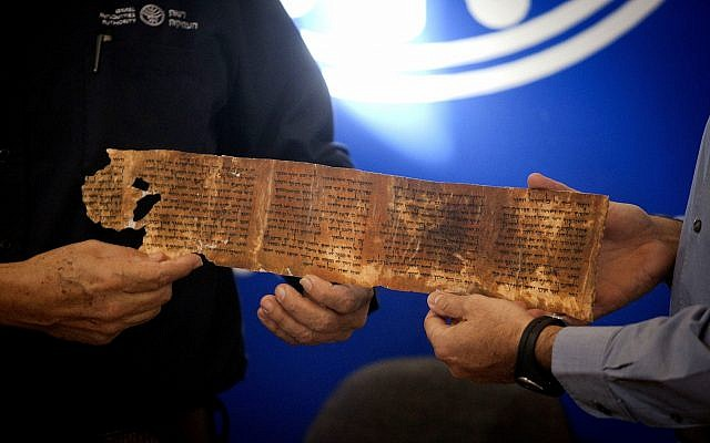 A copy of a part of the Dead Sea Scrolls is shown during a joint Israel Antiquities Authority and Google press conference in Jerusalem, on December 18, 2012. (AP Photo/Dan Balilty)