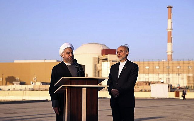 In this photo released by the Iranian Presidency Office, President Hassan Rouhani, left, speaks as he is accompanied by the head of Iran's Atomic Energy Organization Ali Akbar Salehi on a visit to the Bushehr nuclear power plant just outside the port city of Bushehr, southern Iran, Tuesday, Jan. 13, 2015. (AP Photo/Iranian Presidency Office, Mohammad Berno)
