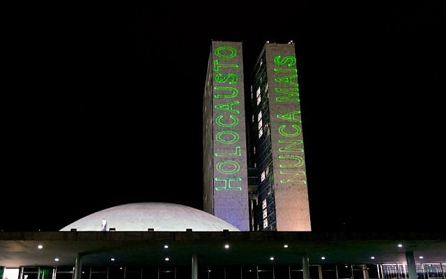 A message for Yom Hashoah, or Holocaust Remembrance Day, is laser-projected on the National Congress buildings in Brasilia, April 11, 2018. (Roque de Sa/Agencia Senado via Fotos Publicas)