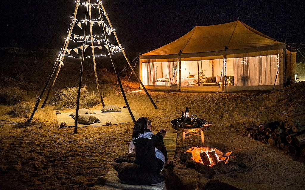 Israel's Tourism Ministry's temporary glamping tent guest with the their winner, Charline Wolff from Germany, indulging in a spot of stargazing (Courtesy Daniel Bear)