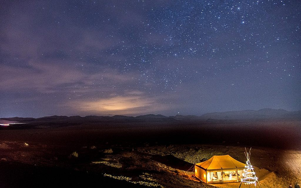 An aerial view of the stars and Tourism Ministry glamping tent set up temporarily in the Ramon Crater as part of an international marketing campaign. (Courtesy, Daniel Bear)