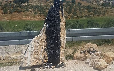 Monument for Eitam and Naama Henkin who were killed in a 2015 drive-by terror attack is found vandalized on April 30, 2018. (Yedidya Asraf)
