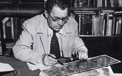 A 1951 image of the Hebrew University's Prof. Eleazar Sukenik with one of the Dead Sea Scrolls. (Department of Archaeology, the Hebrew University, Jerusalem - National Library of Israel, Schwadron collection)