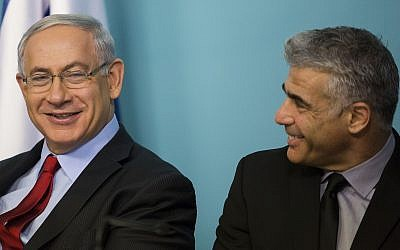 Prime Minister Benjamin Netanyahu and then finance minister Yair Lapid attend a signing ceremony for a new private port to be built in Ashdod, at the Prime Minister's Office in Jerusalem on September 23, 2014. Noam Revkin Fenton/FLASH90)