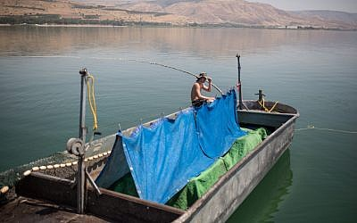 "Illustrative: Fishermen from the kibbutz Ein Gev, seen on the fishing boat ""Gil,"" on the Sea of Galilee, Northern Israel.May 7, 2017. (Maor Kinsbursky/FLASH90)"