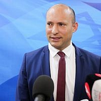 Education Minister Naftali Bennett speaks to press before the weekly cabinet meeting at the Prime Minister's Office in Jerusalem on March 25, 2018. (Marc Israel Sellem/Pool/Flash90)