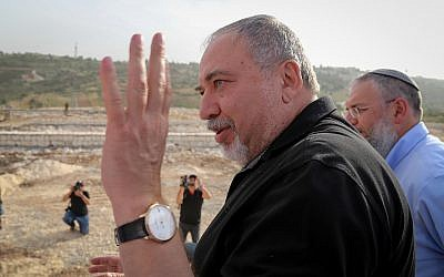 Defense Minister Avigdor Liberman at a cornerstone laying ceremony for a new neighborhood in the Etzion settlement bloc meant to resettle the evacuees of Netiv Ha'avot outpost on March 27, 2018. (Gershon Elinson/Flash90)