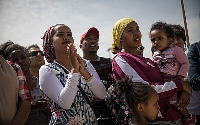 African asylum seekers and Israeli activists protest outside the Prime Minister's Office in Jerusalem, against their deportation, on April 3, 2018. (Hadas Parush/Flash90)