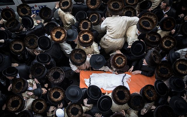 Ultra-Orthodox Jewish men attend the funeral of an infant boy who drowned to death in Ashdod, seen here during the burial ceremony at Kikar Hashabat, Jerusalem, on April 5, 2018. (Noam Revkin Fenton/Flash90)