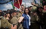 Culture and Sports Minister Miri Regev poses for photographs with Israeli soldiers on April 9, 2018, as she arrives at a press conference at Mt Herzl in Jerusalem, where the official national celebrations will be held in honor of Israel's 70th Independence Day next week. (Yonatan Sindel/Flash90)