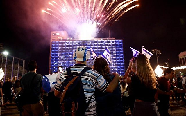 People watch fireworks during a show to mark Israel's 70th Independence Day in Tel Aviv on April 18, 2018. (Miriam Alster/Flash90)