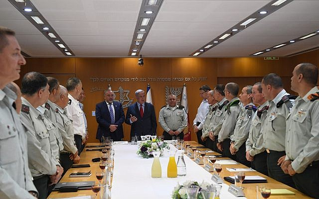 Prime Minister Benjamin Netanyahu (C) and Defense Minister Avigdor Liberman (center left) attended a toast with IDF Chief-of-Staff Lt.-Gen. Gadi Eizenkot (center Right) and the General Staff Forum on the occasion of the State of Israel's 70th Independence Day, on April 22, 2018. (Kobi Gideon / GPO)