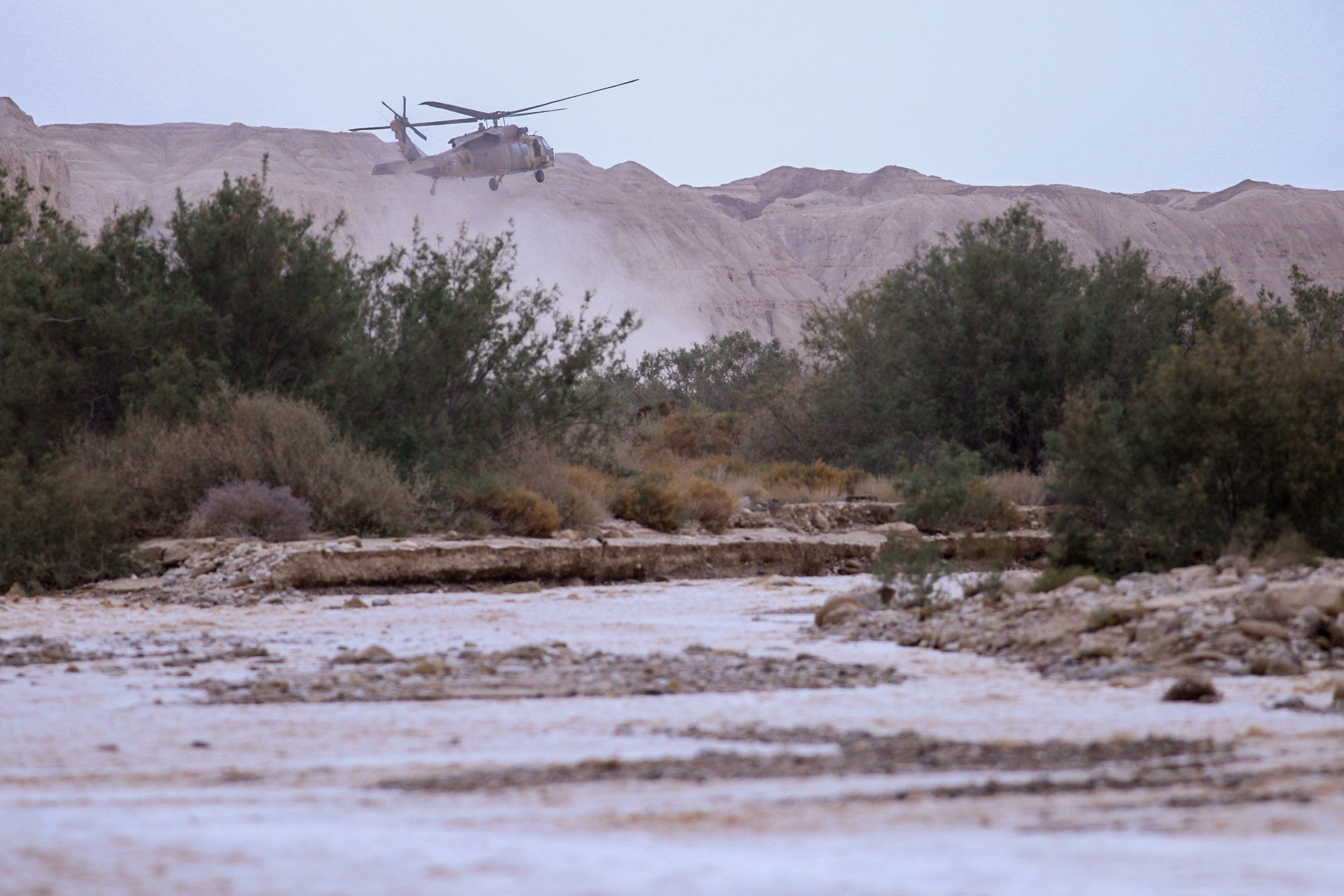 A military helicopter searches for missing students near the Dead Sea southern Israel