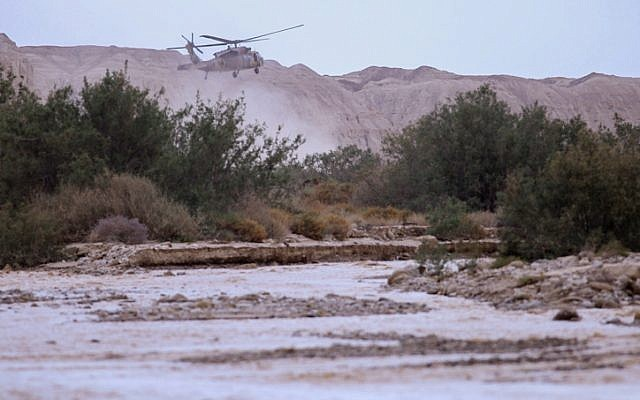 Military helicopters search for missing teens swept away in the flooding of the Tzafit Stream near the Dead Sea in southern Israel, on April 26, 2018. (Maor Kinsbursky/Flash90)