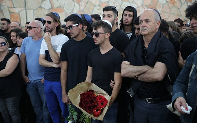 Family and friends mourn during the Funeral of Maayan Barhom at the Har Hamenuchot cemetery in Jerusalem, Friday, April 27, 2018. Barhom was killed yesterday along with 9 other teens when they were swept in a flooding at the Tzafit Stream during a class trip near the Dead Sea. (Hadas Parush/Flash90)