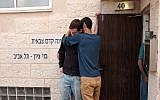 People seen outside the Bnei Zion pre-military academy in Tel Aviv, from which 10 youths were killed in a flash flood in the Judean Desert, on April 27, 2018. (Tomer Neuberg/ Flash90)